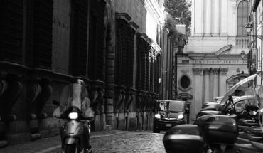 A rare calm street in Rome.