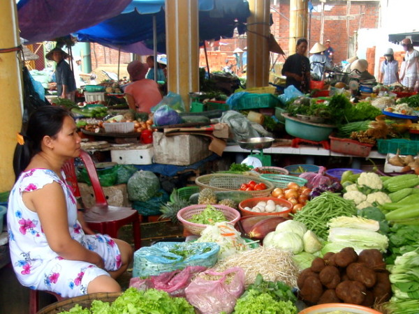 What a lonely job this must be - a woman waits for customers at a food market outside Hoi An, Vietnam.