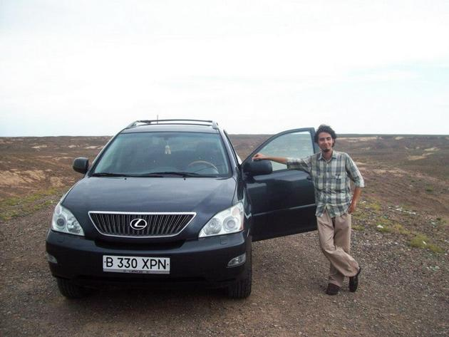 Nenad posing with his driver's car in Kazakhstan.