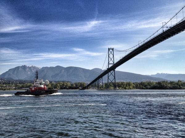 Tug boat about to go under Lions Gate Bridge