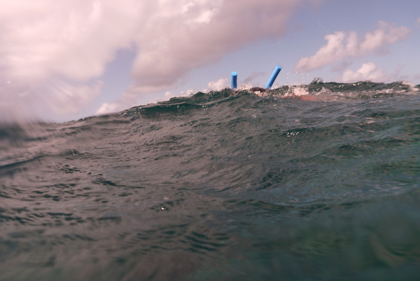 A snorkeller over the waves