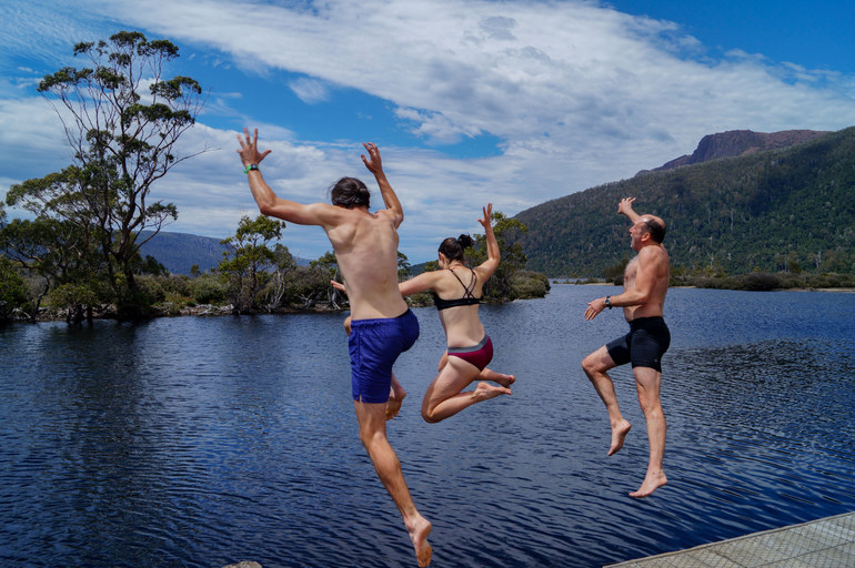 Jumping into Lake St Clair after the  Overland Track